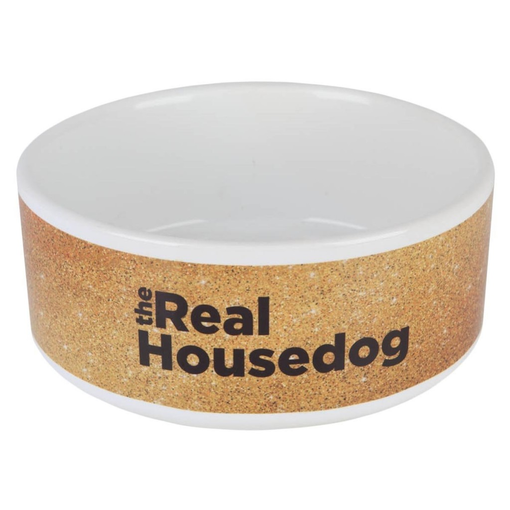 "This is a dog food bowl made by Bravo TV with the words ""The Real Housedog,"" written on it."