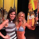 Heather Dubrow on stage with Tamra Judge At A Fitness Competition