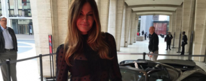 kelly bensimon posing with a car