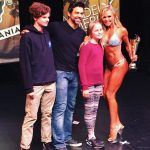 Tamra Judge posing for a picture at a fitness competition.