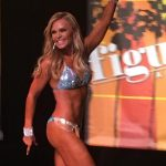 Tamra Judge walks the stage at a fitness competition.