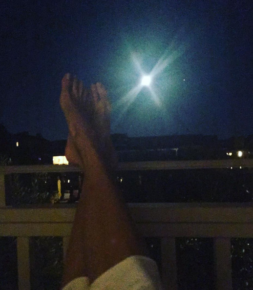 Yolanda Hadid kicking her feet up while looking at the beautiful San Francisco moon. How can you be mad when you have a beautiful, relaxing night like this?