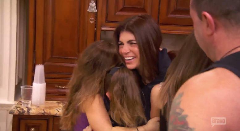 teresa giudice hugging her daughters
